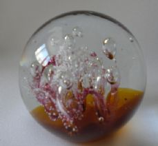 Glass Round Bubble Paperweight. Amber/Pink